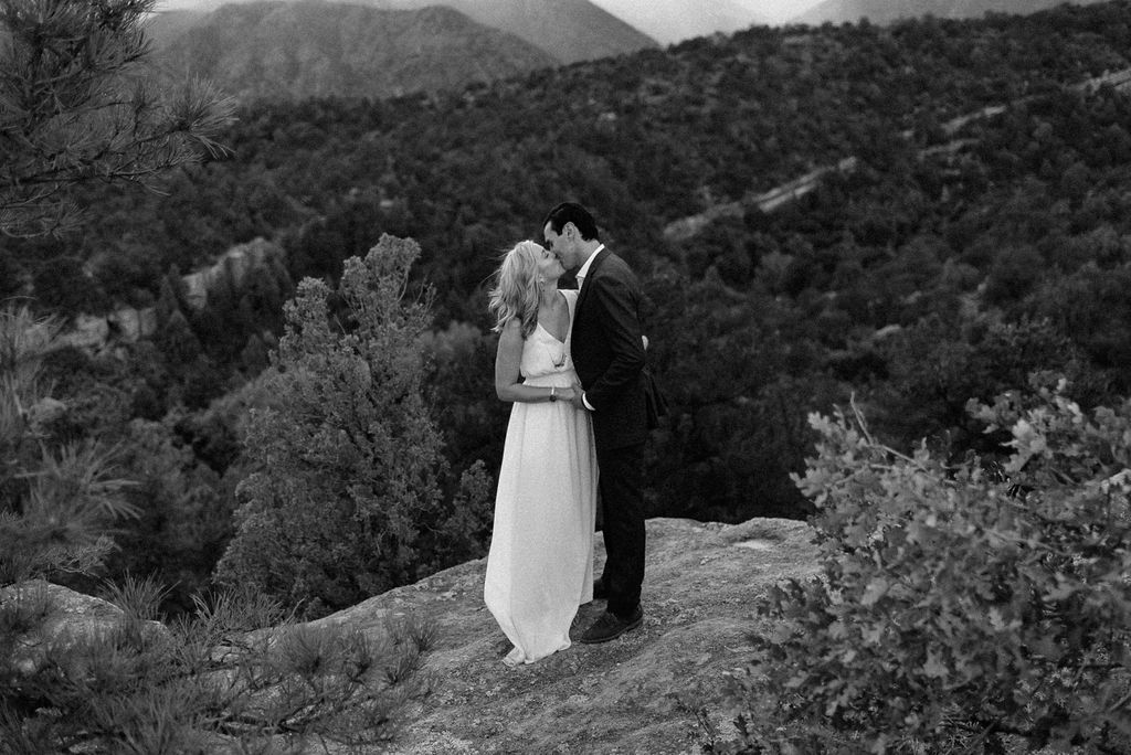 Couple kisses at Garden of the Gods