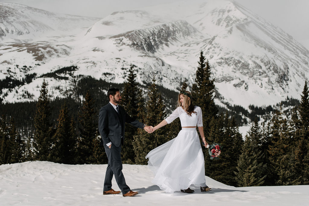 Magical Bride and Groom Portraits in Breckenridge on top of a mountain in the snow