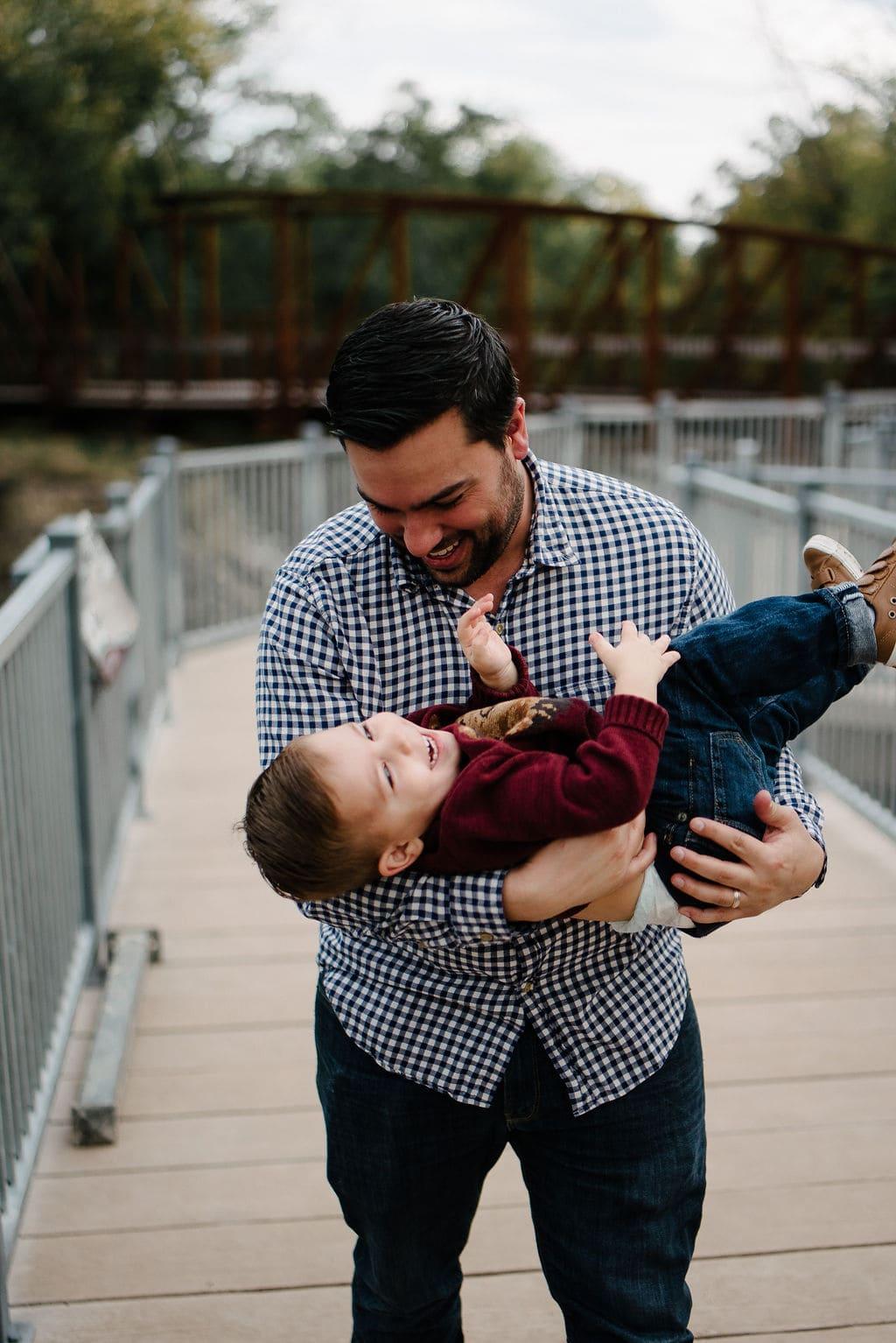 playful father son photos