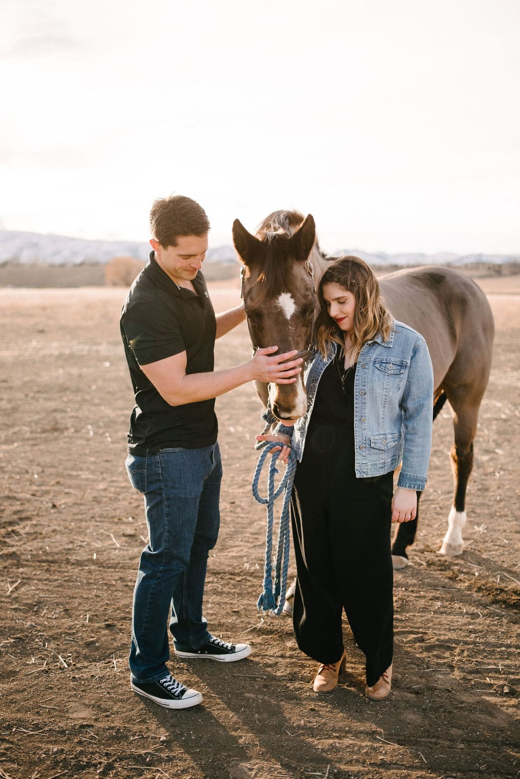 Colorado engagement session. Engagement Session with Horses. Jean Jacket and Romper