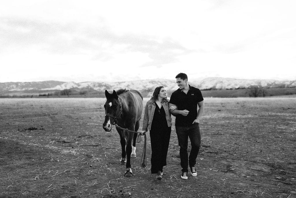 Playful Engagement Session with horses. Fort Collins Engagement Session