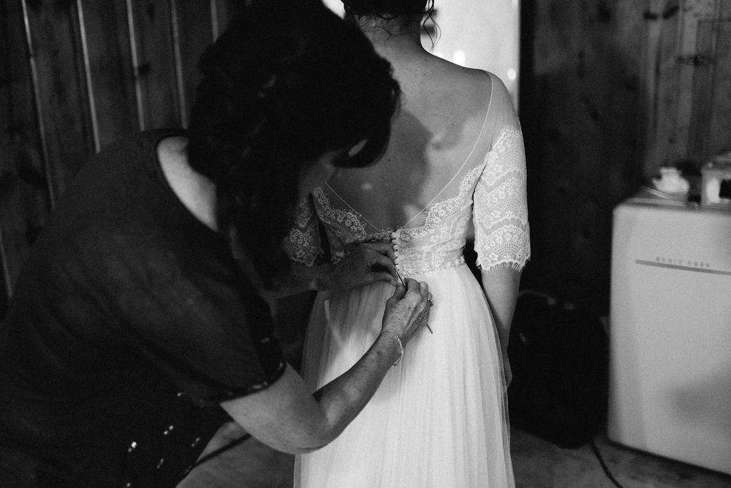 buttoning the brides dress