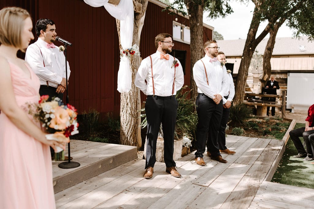groom waiting on bride at ceremony