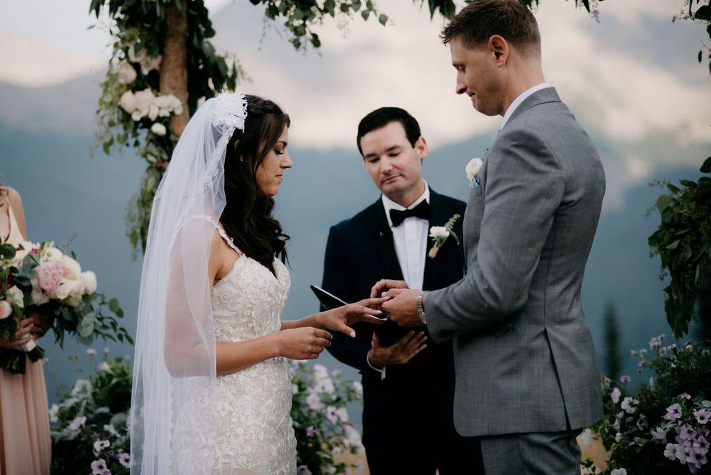 Bride and Groom exchanging rings in Winter Park