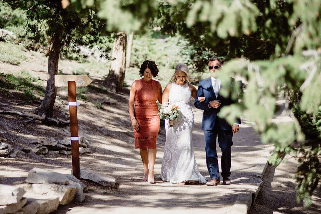 Bride walking down aisle at sapphire point