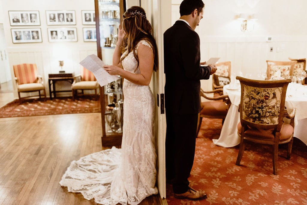 Bride and Groom First Touch reading letters to each other
