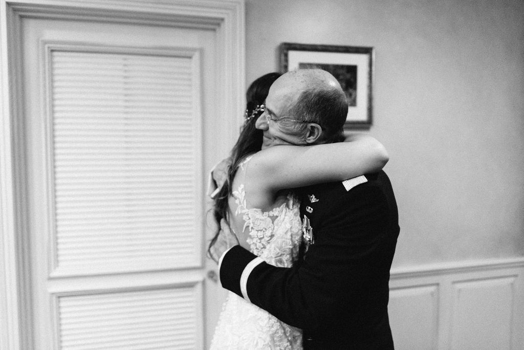 father of the bride sees his daughter for the first time in her wedding dress