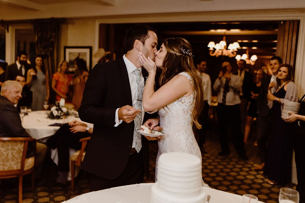 Bride and Groom cut the cake at Cheyenne Mountain Country Club Wedding Reception