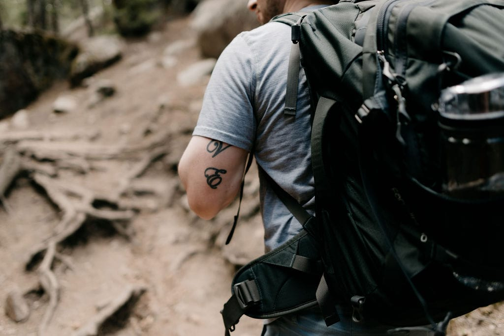 Hiking with an Osprey backpack in evergreen colorado