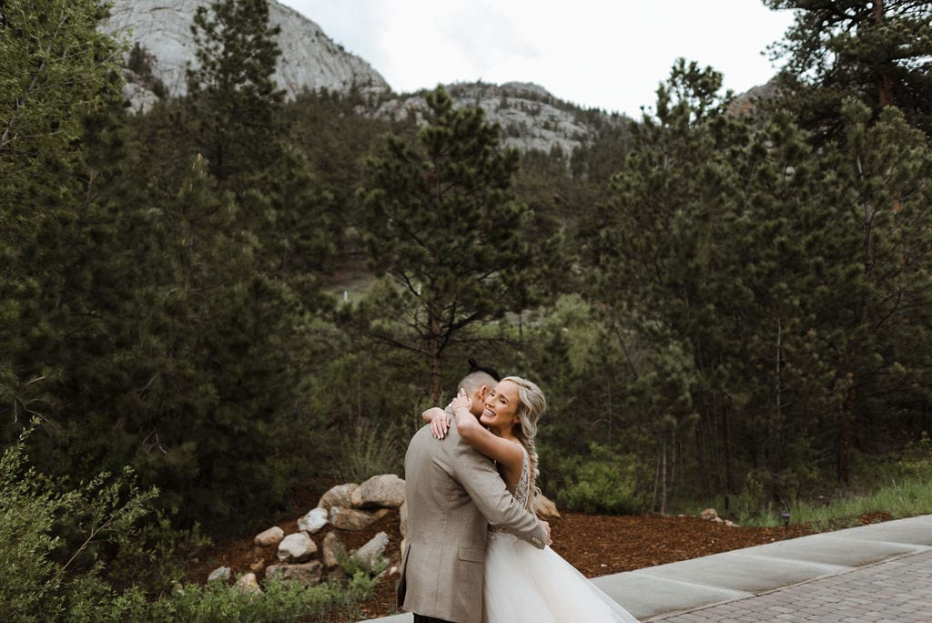 First look between bride and groom at Della Terra in Estes Park
