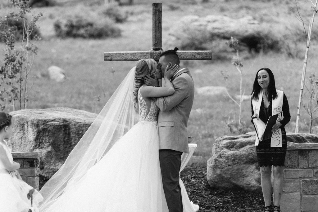 Bride and Groom Kiss at Della Terra Wedding in Estes Park, Colorado