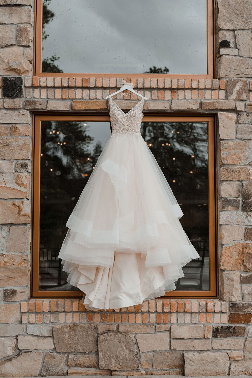 Wedding Dress hanging on the side of Della Terra Wedding Venue
