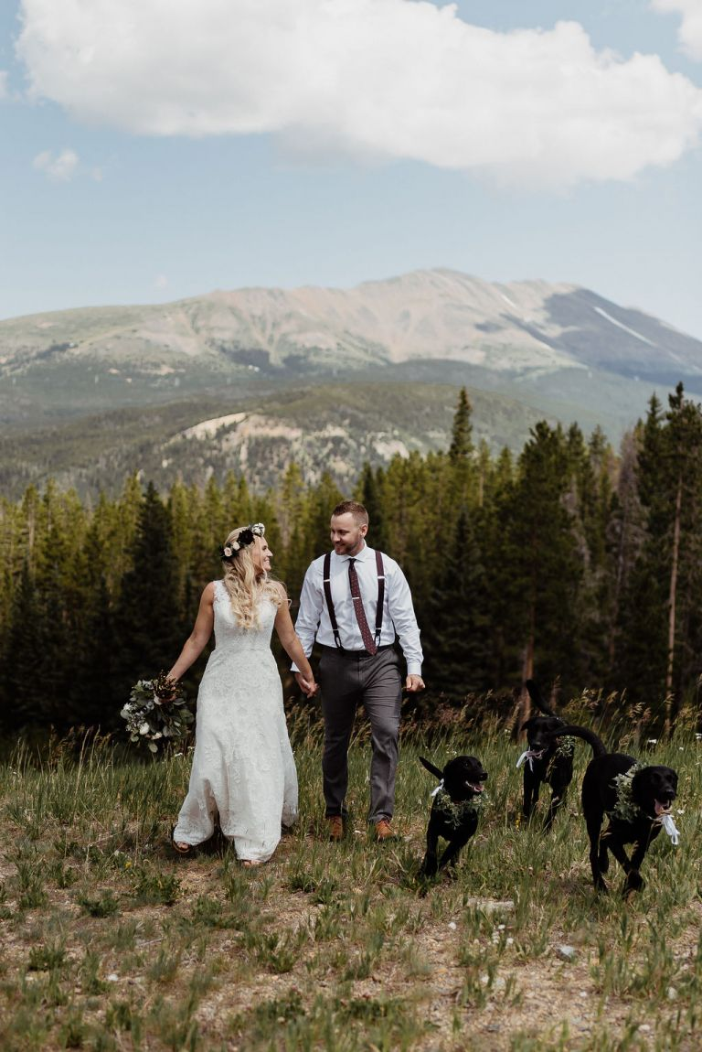 Couple on their wedding day with their dogs in the mountains of breckenridge