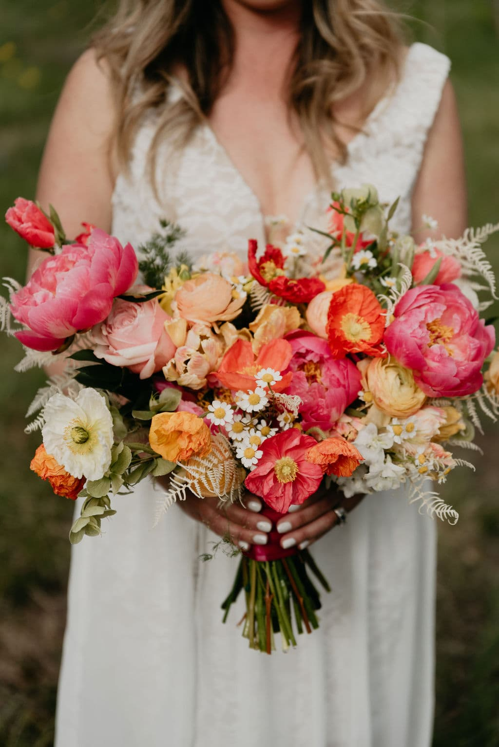 Painted Primrose wedding florals with corals and pinks and yellows