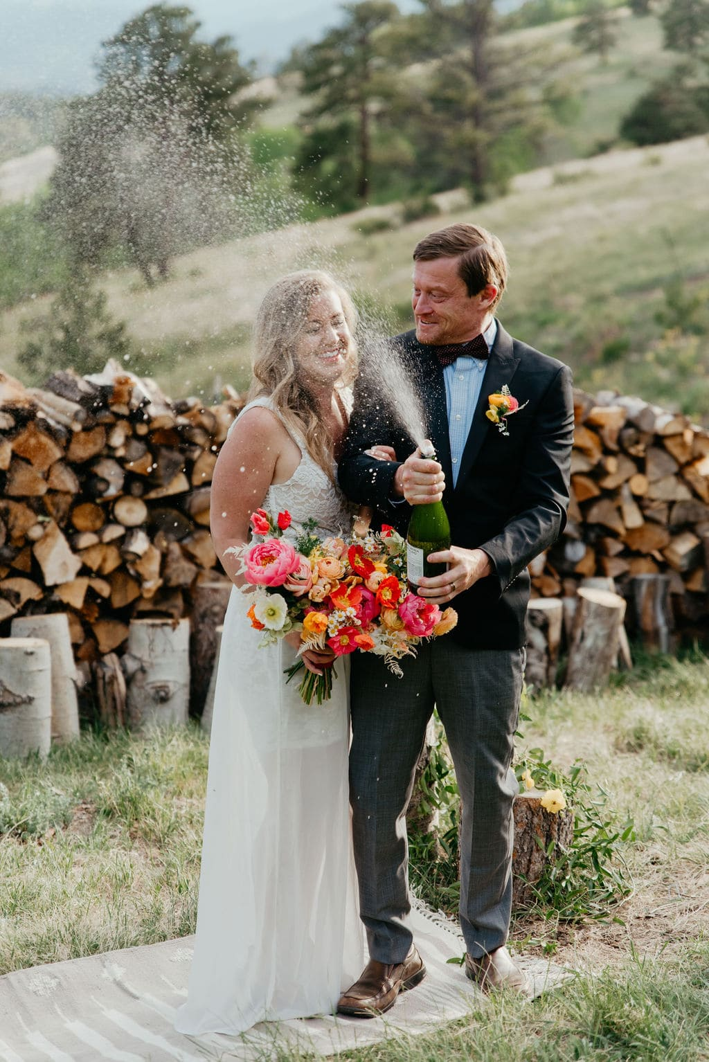 New elopement location for couples in colorado popping champagne