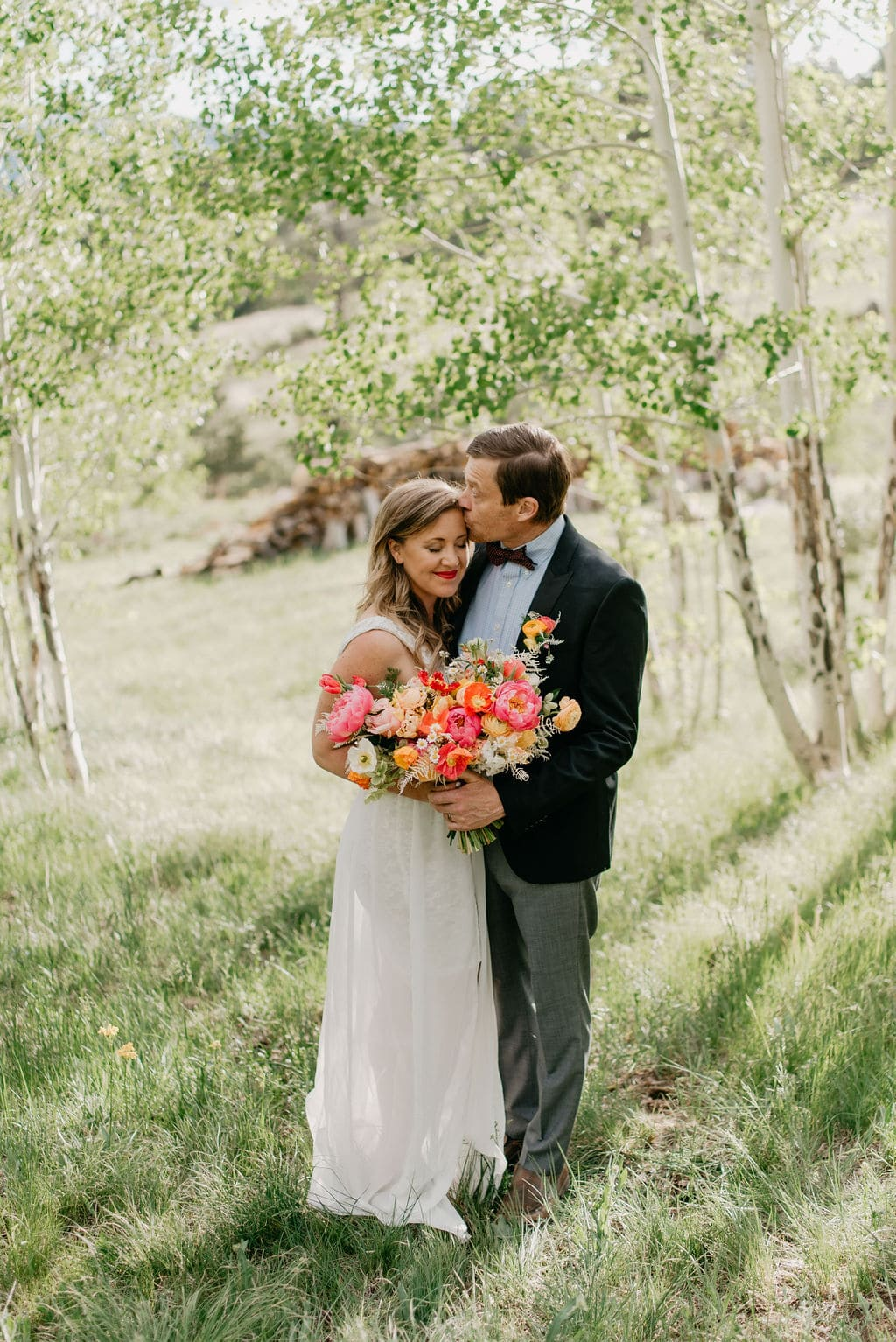 Romantic bride and groom portraits in golden colorado aspen grove