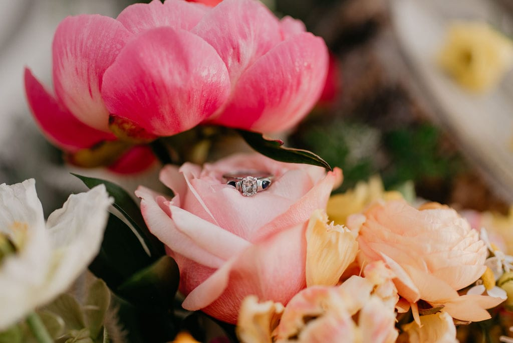 wedding ring in pretty pink rose bouquet