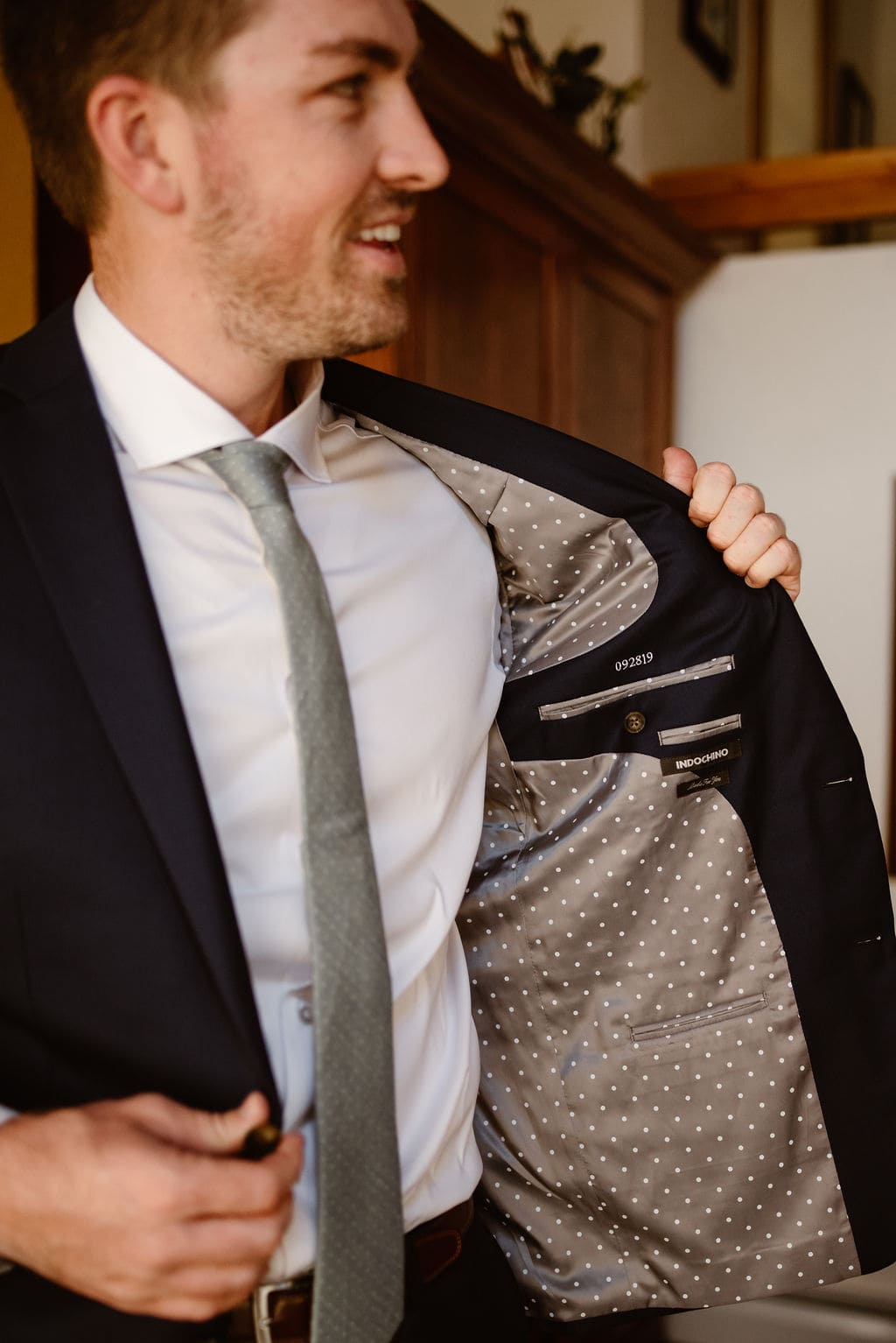 Wedding date sewn into grooms suit jacket