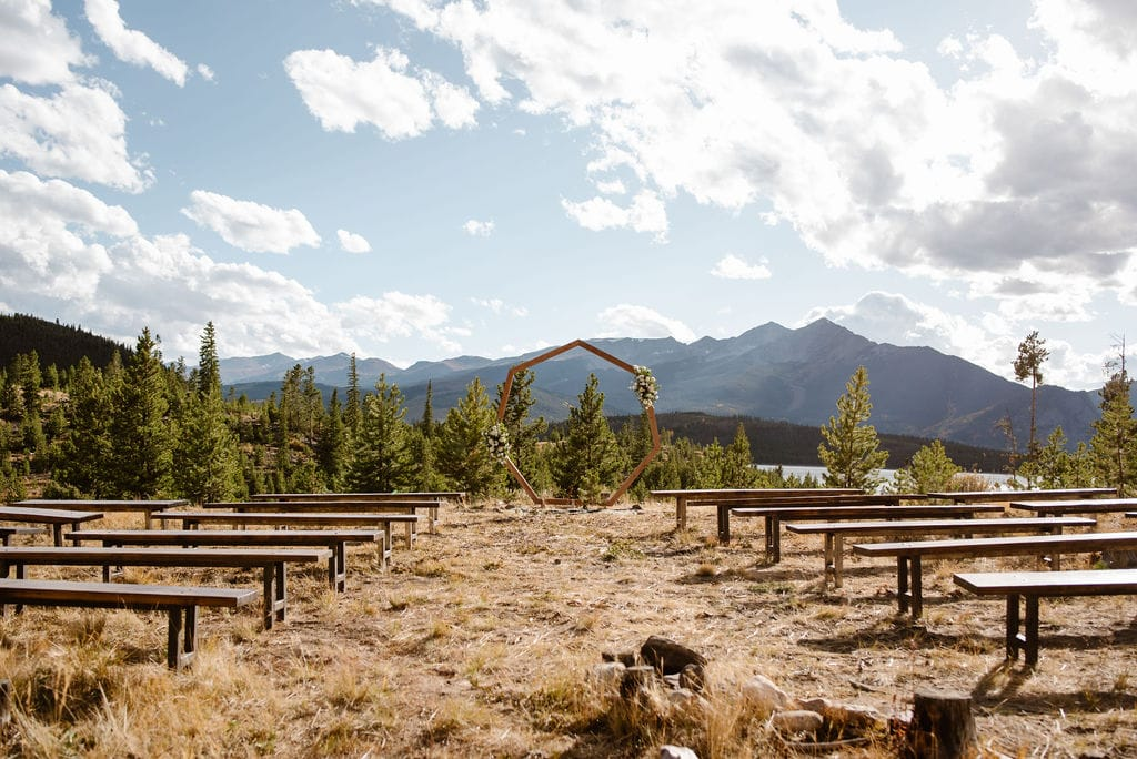 Beautiful outdoor ceremony location for a Colorado Campground Wedding with Mountain Views