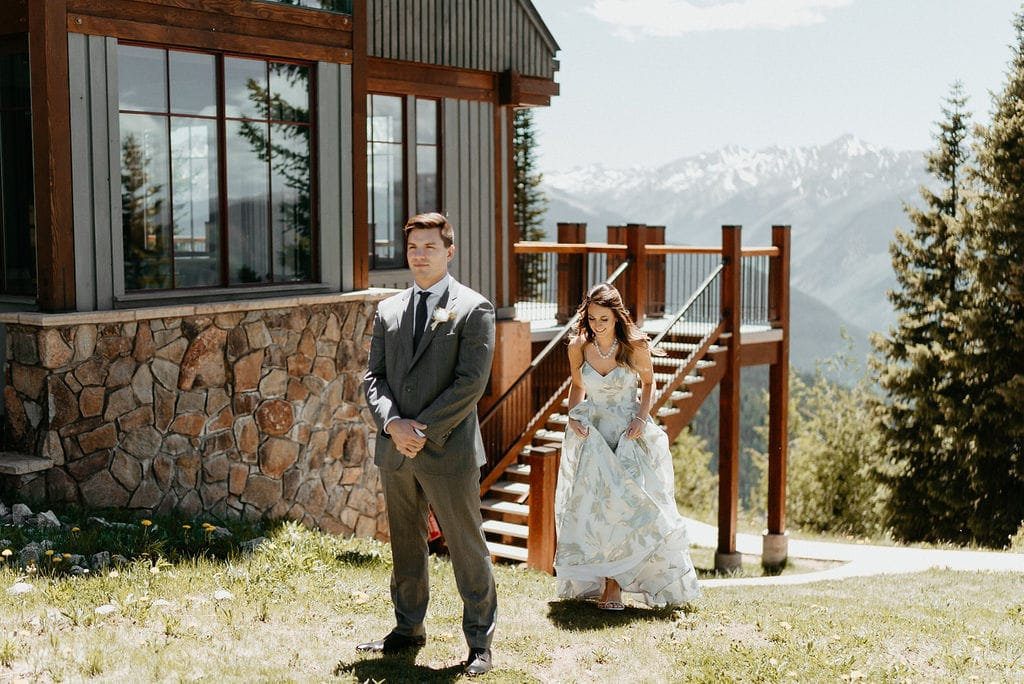 Bride and groom first look on Aspen Mountain at their wedding