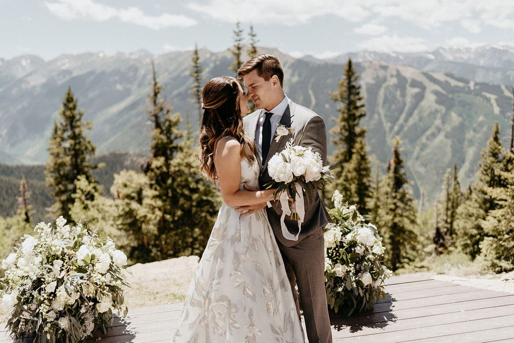 Bride and groom at the sundeck on aspen mountain at their Aspen Wedding