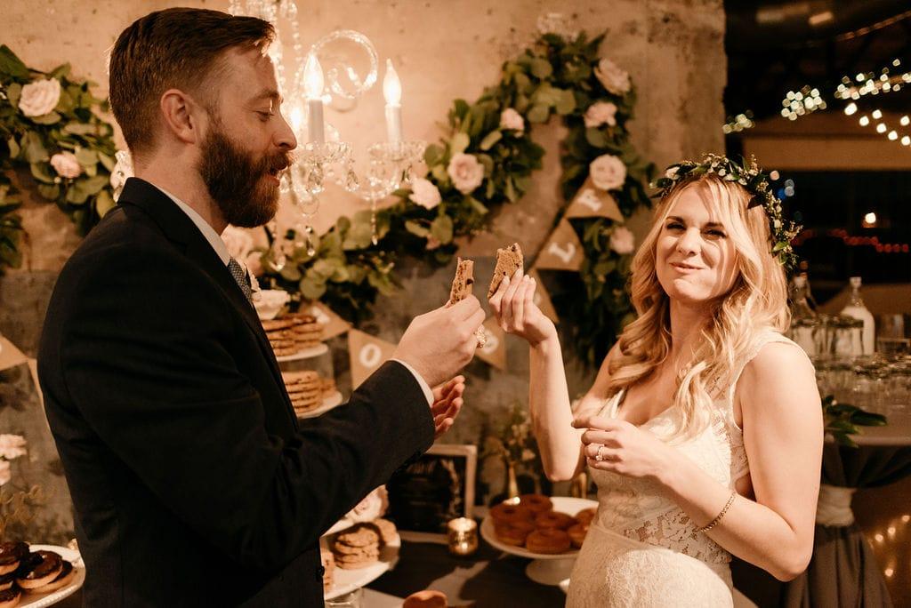 Bride and groom Breaking cookie at wedding reception