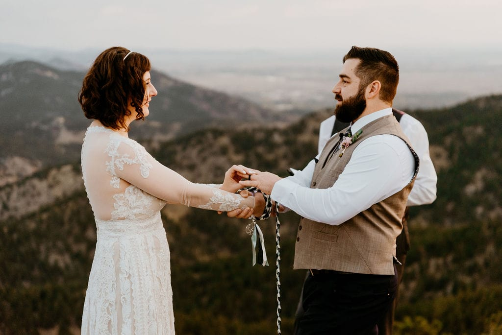 Bride and Groom exchange Rings at Boulder Elopement