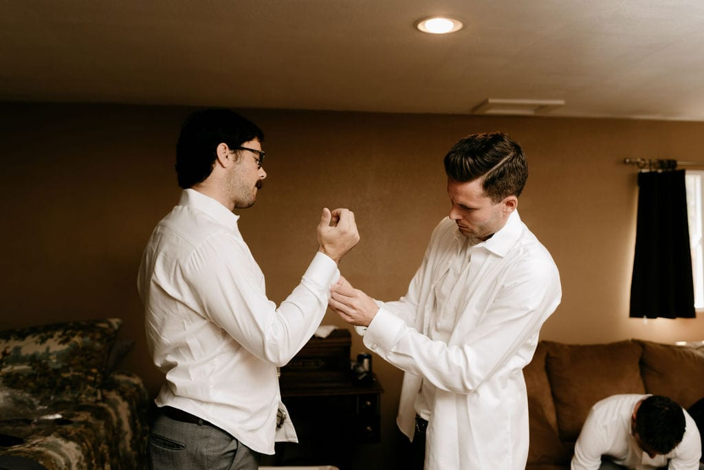 Groom getting ready with groomsmen