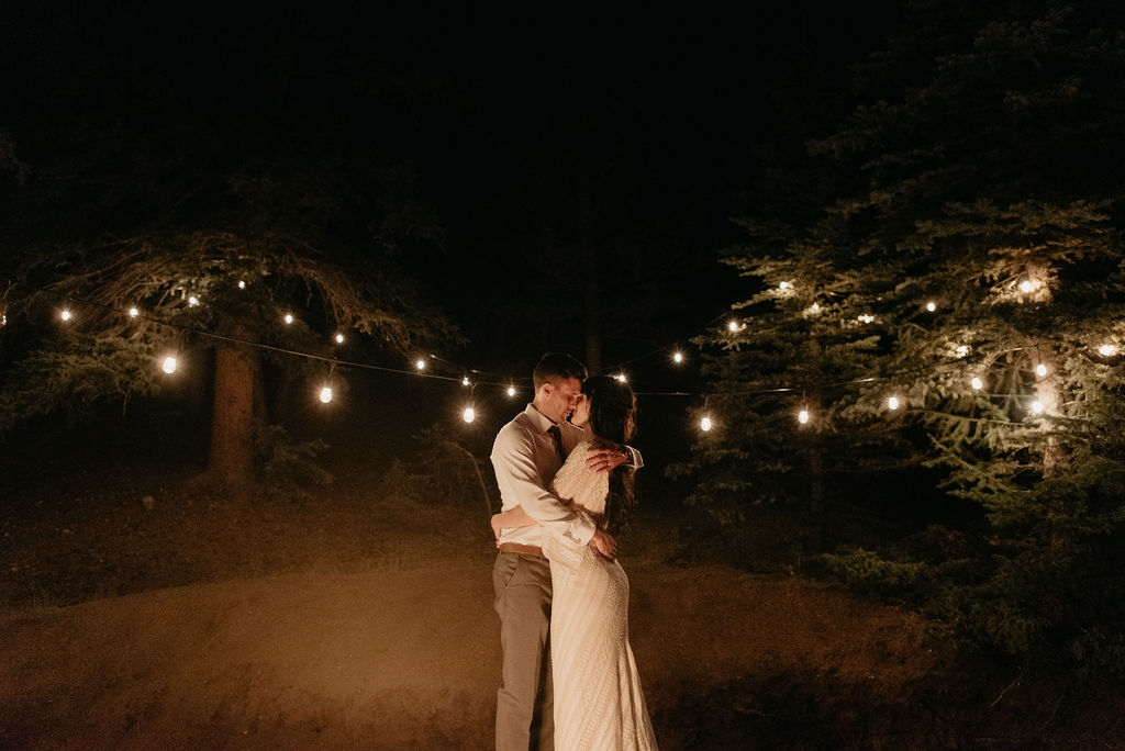 Romantic wedding portraits by fire pit at mountain view ranch