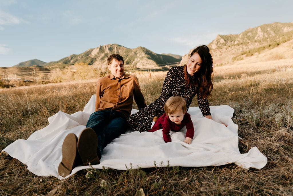 Boulder Family session at sunrise with flatirons in the background