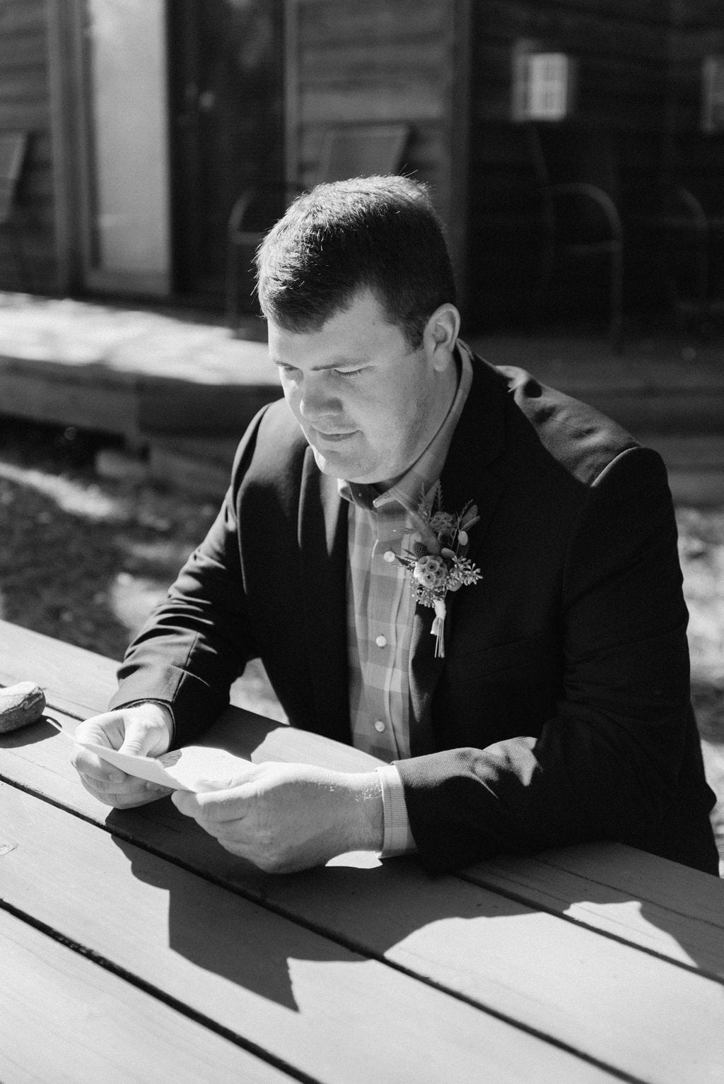 Groom Reads Letter from bride before his sprague lake elopement
