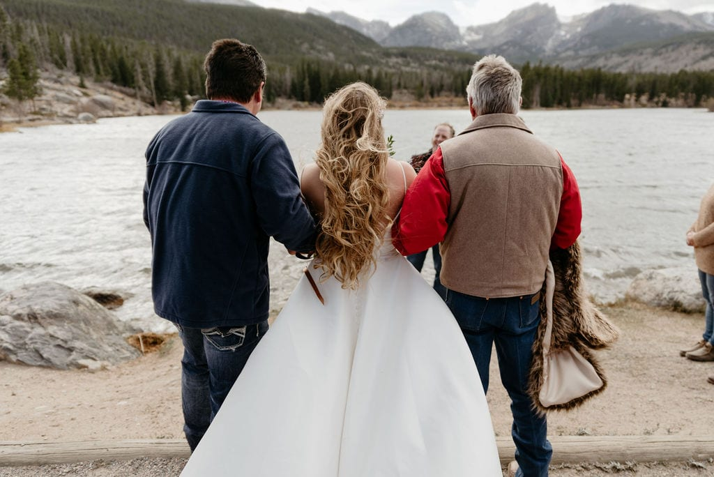 Bride walking down the aisle in estes park