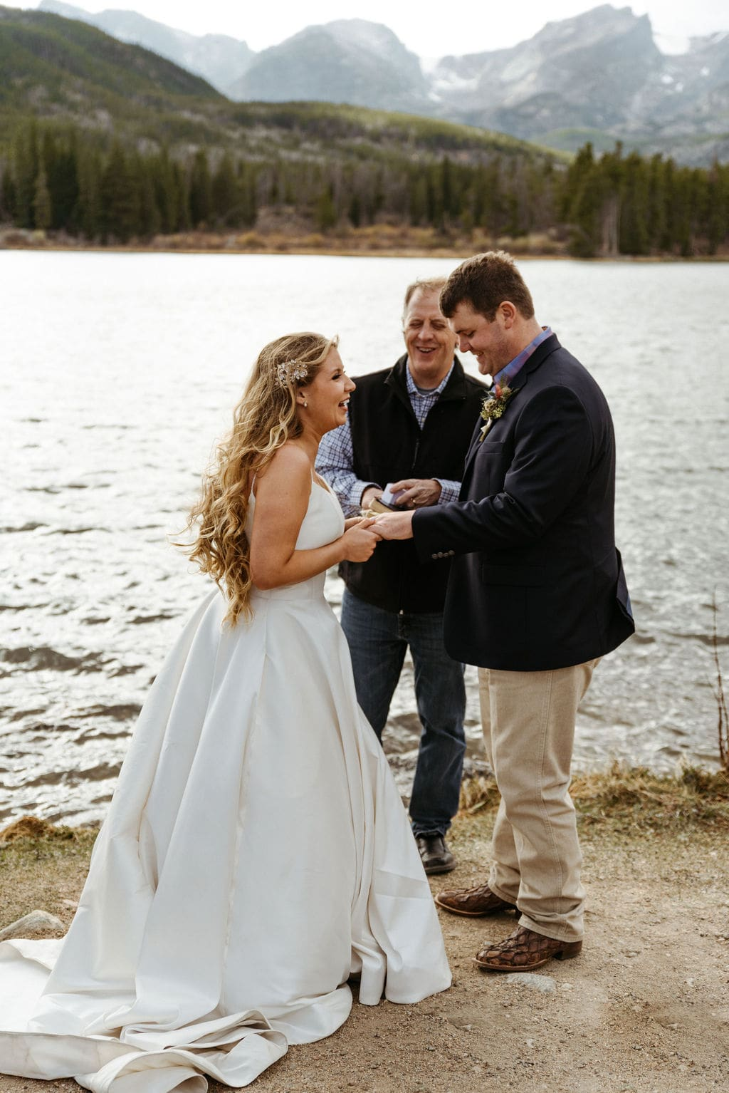 Bride and groom exchange rings at their sprague lake elopement