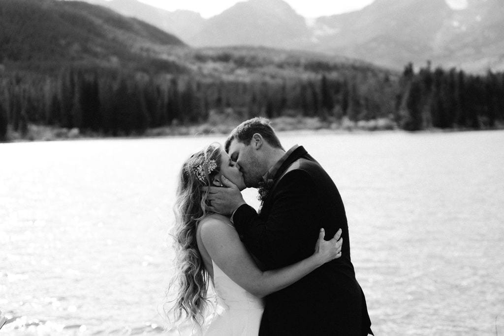 Bride and grooms first kiss at their rocky mountain national park elopement