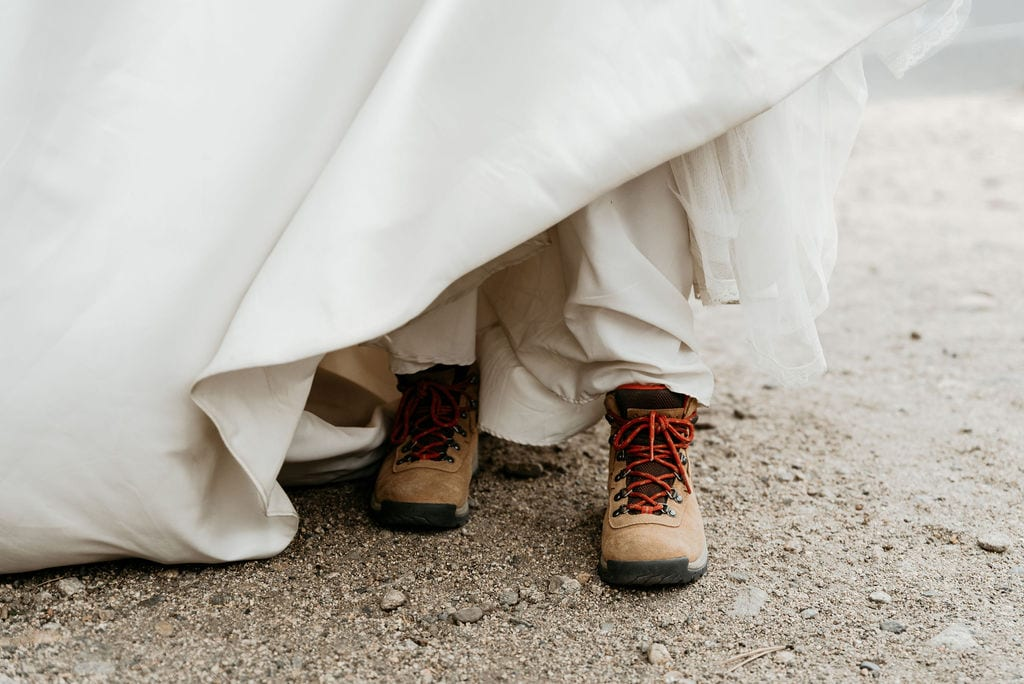 Bride in hiking boots in estes park
