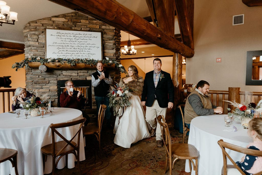 Bride and groom enter their estes park resort reception