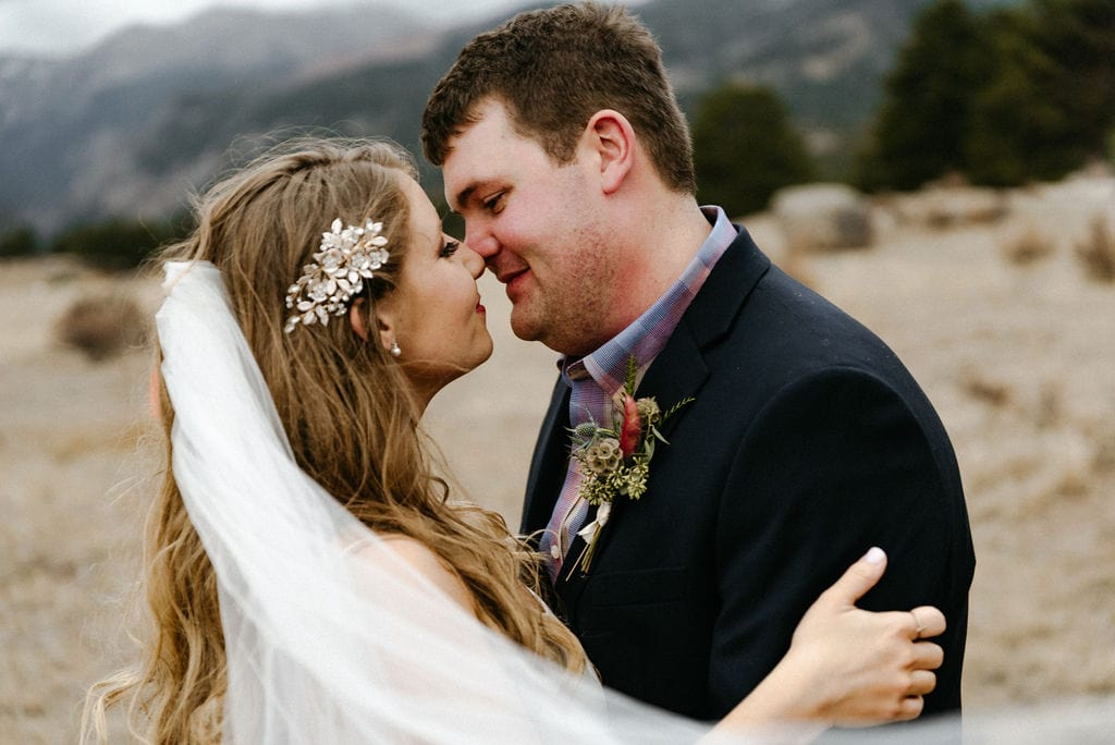 Romantic photo of bride and groom on their wedding day in estes park. Rocky Mountain National Park Elopement
