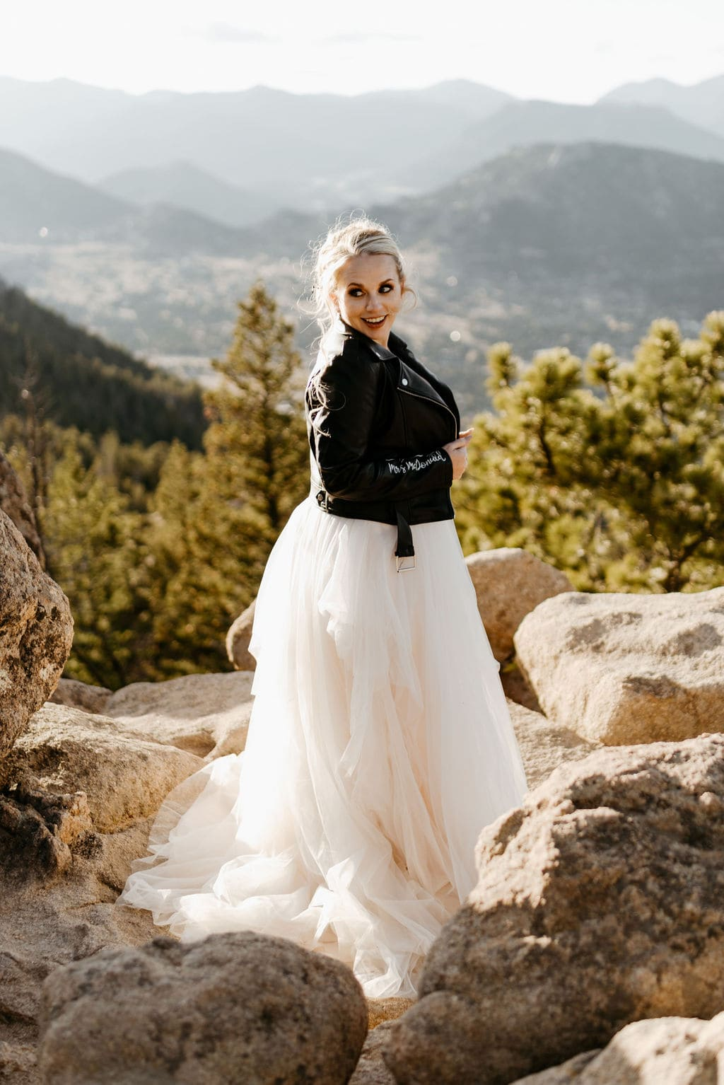 Bride Poses for photo on the edge of a mountain at her hermit park elopement