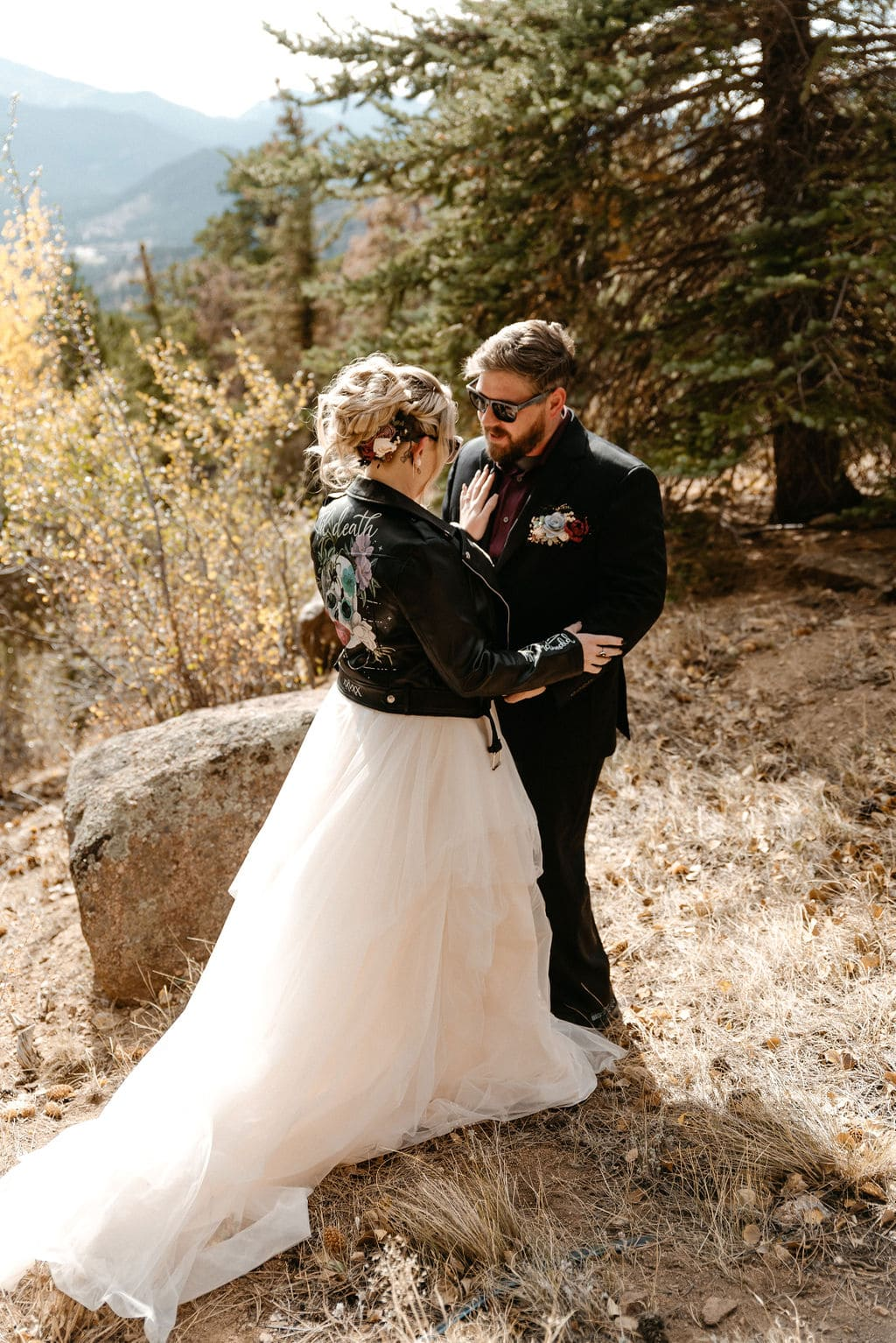 Bride and groom kiss before their estes park elopement at their first look