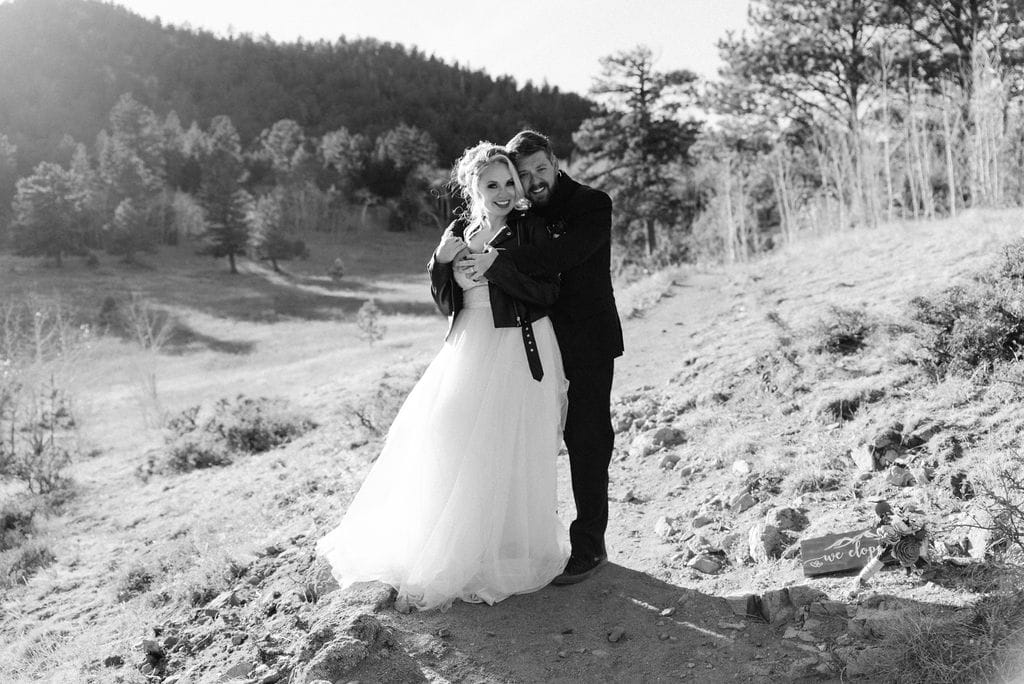 Romantic bride and groom portraits in the mountains in Hermit park