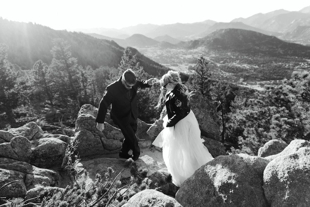 Bride and groom get ready to take photos on Kruger Rock Overlook in Estes Park, Colorado