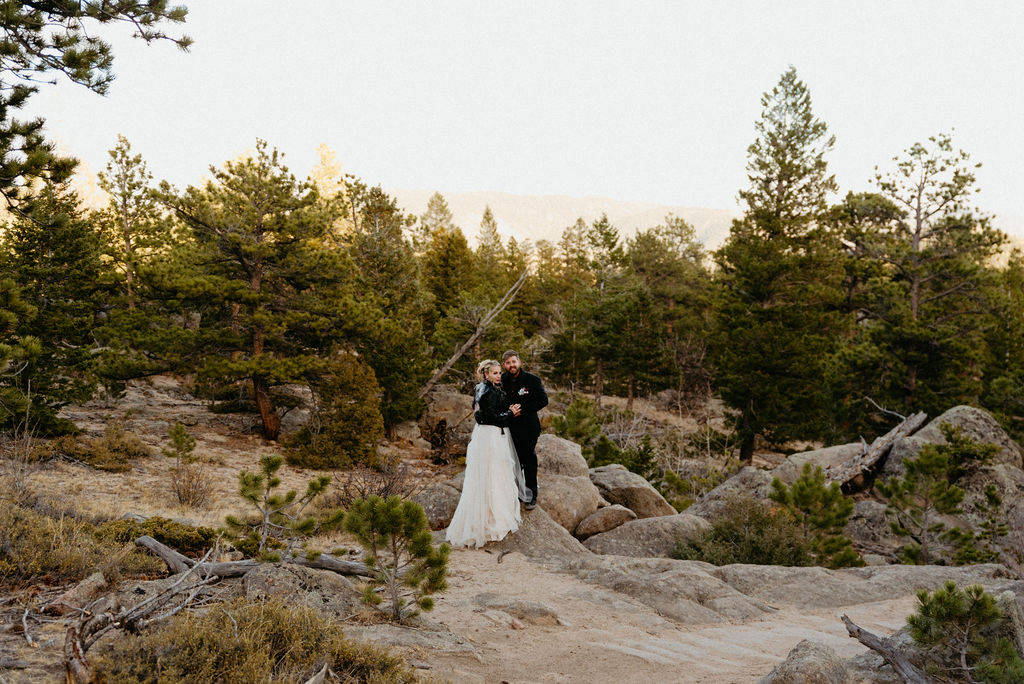 Bride and groom on a trail in hermit park after their estes park elopement